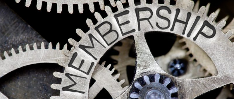 Macro photo of tooth wheel mechanism with MEMBERSHIP concept letters